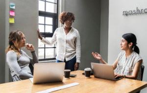 women in leadership, woman leading meeting